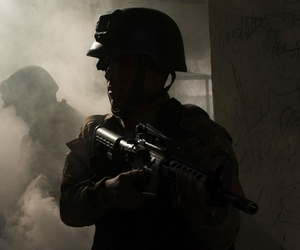 Iraqi Counter-Terrorism Service soldiers coordinate to tactically enter and clear rooms during an urban operation terrain exercise near Baghdad, Iraq.