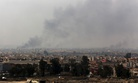 Smoke rises from the western side of Mosul following a U.S.-led coalition airstrike, in Mosul, Iraq, Monday, Jan. 30, 2017.