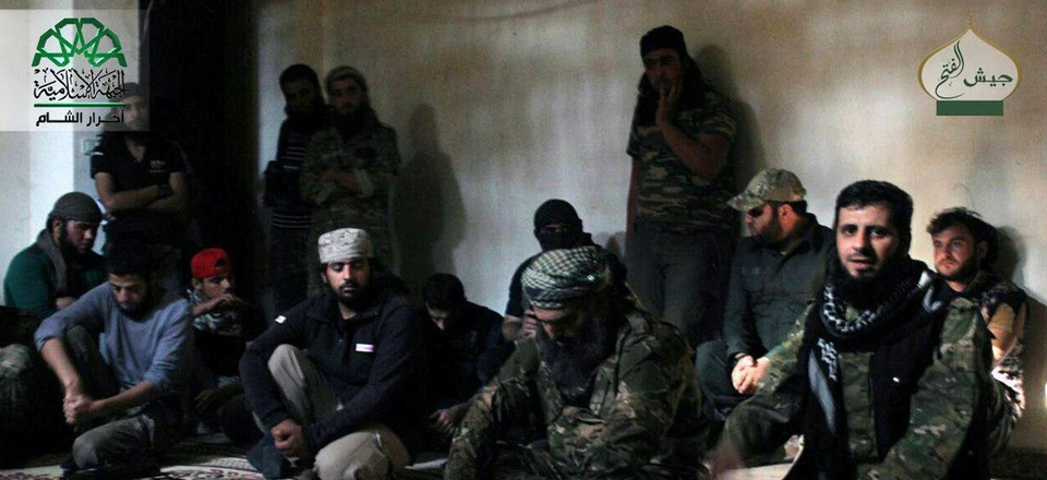 n this file photo posted, Sunday, Oct. 30, 2016, by the Syrian militant group Ahrar al-Sham, shows the general commander of Ahrar al-sham, Mohannad al-Masri, center, visiting fighters in rural western Aleppo, Syria.
