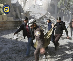 "The real ""White Helmets, Syrian Civil Defense workers and Syrian citizens carry a dead body in the neighborhood of Seif al-Dawleh in Aleppo, Syria, Saturday, Nov. 19, 2016."