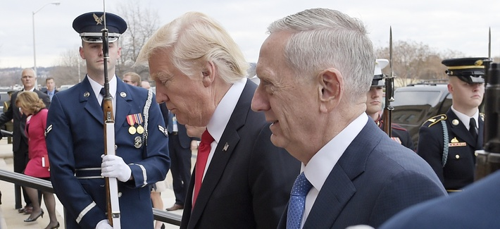 U.S. Defense Secretary Jim Mattis, right, and U.S. President Donald Trump walk into the Pentagon in Washington, Jan. 27, 2017.