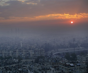 In this Jan. 20, 2017 file photo, the sun rises as blanket of fog covers the Aleppo citadel and the city of Aleppo, Syria.