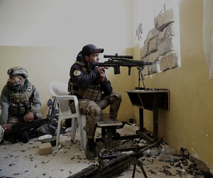 An Iraqi special forces sergeant watches the front line with Islamic State group fighters inside the Mamun neighborhood of western Mosul, Iraq, Thursday March 2, 2017.