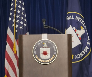 The stage and podium before a press conference at CIA headquarters in Langley, Va., Thursday, Dec. 11, 2014.