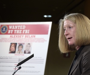Acting Assistant Attorney General Mary McCord speaks during a news conference at the Justice Department in front of a mug shot poster of Russian hackerAlexsey Alexseyevich Belan.