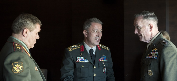 Marine Corps Gen. Joseph Dunford Jr., right, chairman of the Joint Chiefs of Staff, speaks with Gen. Hulusi Akar of the Turkish army, center, and Gen. Valery Gerasimov of the Russian army in Antalya, Turkey, March 6, 2017.