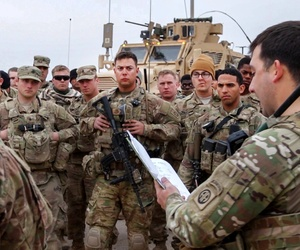 U.S. Army Rangers are briefed south of Mosul at Qayyarah West Airfield, Iraq, Feb. 17, 2017, before moving out to Hamam al-Alil.