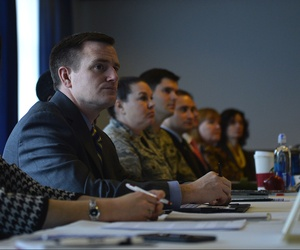 Military and civilian defense contracting representatives attend a meeting at Ramstein Air Base, Germany, Jan. 24, 2017.