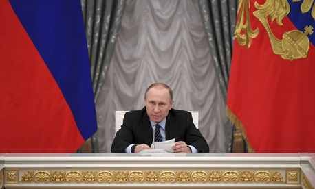 Russian President Vladimir Putin chairs a meeting of the Presidential Council for Strategic Development and Priority Projects at the Kremlin in Moscow, Tuesday, March 21, 2017.