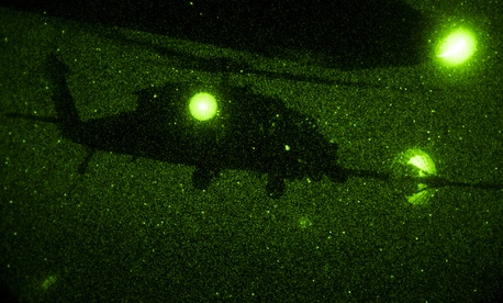 HH-60 Pavehawk from the 303rd Expeditionary Rescue Squadron, performs a night-time Helicopter Air-to-Air Refuel (HAAR) with a C-130 Hercules from the 82nd Expeditionary Rescue Squadron during a night training flight over Djibouti, Africa, March 20, 2017.