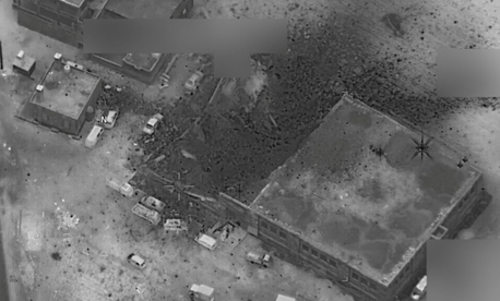 A photo of a March 16 airstrike by U.S. forces on a building that U.S. officials said was the scene of an al-Qaeda meeting.