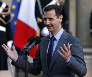 Syria President Bashar al-Assad addresses reporters following his meeting with French President Nicolas Sarkozy at the Elysee Palace in Paris, Thursday Dec. 9, 2010.
