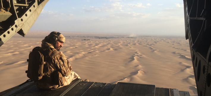 In this Sept. 17, 2015 photo, an Emirati gunner watches for enemy fire from the rear gate of a United Arab Emirates Chinook military helicopter flying over Yemen.