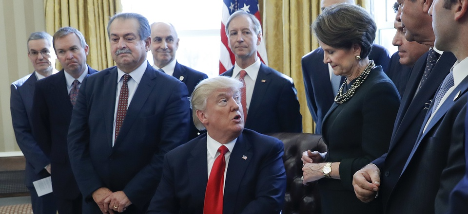 President Donald Trump looks over to Marillyn Hewson, Lockheed Martin chairman, CEO and president, before signing an executive order in the Oval Office on Feb. 24.