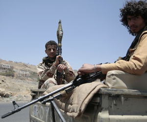Shiite fighters, known as Houthis, secure a roadfrom Sanaa to the port city of Hodeidah, Yemen, Wednesday, Apr. 19, 2017.