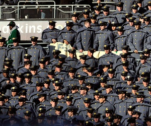 Army cadets look on as their team falters afield during the annual Navy vs. Army college football in 2011