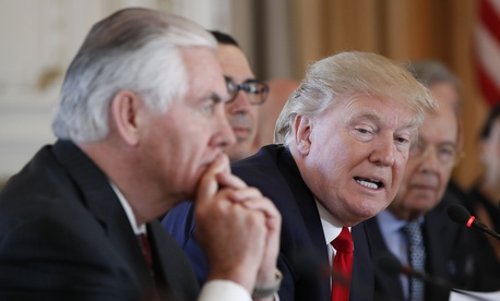 President Donald Trump, joined by Secretary of State Rex Tillerson, left, speaks during a bilateral meeting with Chinese President Xi Jinping at Mar-a-Lago, Friday, April 7, 2017, in Palm Beach, Fla.