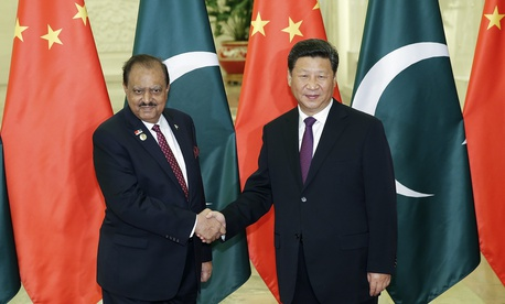 In this 2015 photo, Chinese President Xi Jinping, right, shakes hands with Pakistan President Mamnoon Hussain at the Great Hall of the People in Beijing.