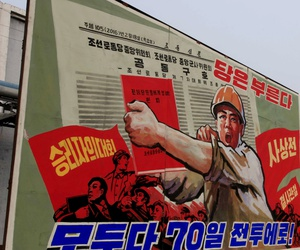 "This North Korean propaganda billboard reads: ""Party is calling. Everybody to the 70-day campaign."""
