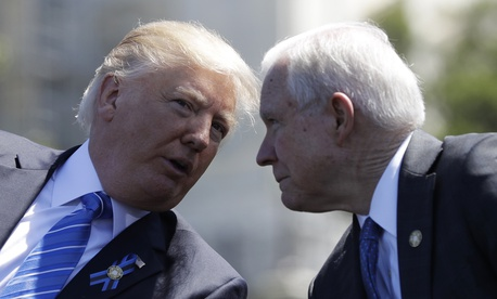President Donald Trump talks with Attorney General Jeff Sessions, gestures before speaking at the 36th Annual National Peace Officers' memorial service, Monday, May 15. 2017, on Capitol Hill in Washington.