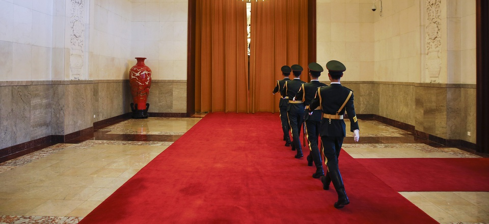 Uniformed guards march inside the Great Hall of the People in Beijing, China, Tuesday, May 16, 2017.