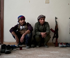 In this Nov. 1, 2014 photo, Kurdish fighters have a short tea break from fighting in Kobani, Syria.