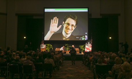 NSA leaker Edward Snowden appears on a live video feed broadcast from Moscow at an event sponsored by the ACLU Hawaii in Honolulu on Saturday, Feb. 14, 2015.
