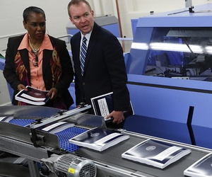 White House budget director Mick Mulvaney, right, joined by GPO Director Davita Vance-Cooks, inspects the production run of President Donald Trump's fiscal 2018 federal budget, May 19, 2017.