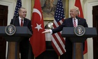 President Donald Trump reaches to shake hands with Turkish President Recep Tayyip Erdogan in the Roosevelt Room of the White House in Washington, Tuesday, May 16, 2017.