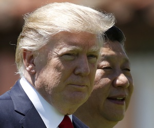 In this April 7, 2017, file photo, U.S. President Donald Trump and Chinese President Xi Jinping walk together at Mar-a-Lago in Palm Beach, Fla.