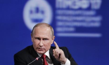 n this Friday, June 2, 2017, file photo, Russian President Vladimir Putin gestures as he speaks at the St. Petersburg International Economic Forum in St. Petersburg, Russia.
