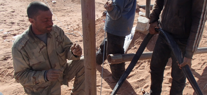 Members of Maghawir al-Thawra work to repair a water well in At Tanf Garrison in southern Syria for partner forces fighting ISIS and locals in the area.