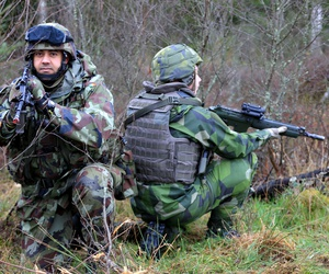 An Irish sergeant and a member of the Swedish Armed Forces participate in the EU Battle Group Sweden's Exercise Joint Action in 2014.