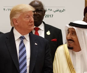 President Donald Trump talks with Saudi King Salman at the Arab Islamic American Summit, at the King Abdulaziz Conference Center, Sunday, May 21, 2017, in Riyadh, Saudi Arabia.