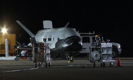 The U.S. Air Force X-37B, named Orbital Test Vehicle 1 (OTV-1), sits on the Vandenberg Air Force Base, Calif., runway during post-landing operations Dec. 3, 2010.