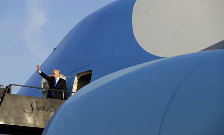 President Donald Trump waves as he boards Air Force One at Newark Liberty International Airport in Newark, N.J., Sunday, June 11, 2017.