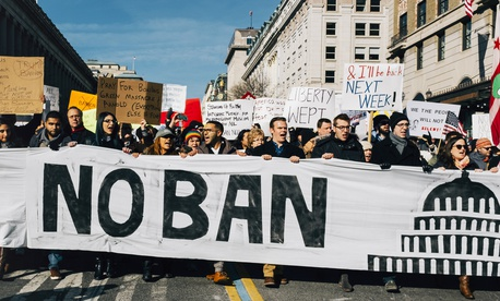 Protestors opposed to President Donald Trump's travel ban march in Washington, D.C., on February 4, 2017