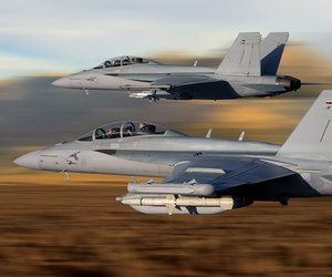 Two F/A-18s aloft in 2015.