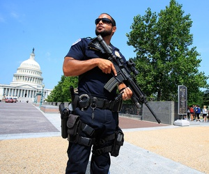 Capitol Hill Police officer Nathan Rainey stands guard on Capitol Hill in Washington, Wednesday, June 14, 2017.