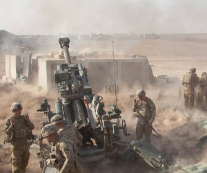 US. Army soldiers fire an M777 howitzer A2 near Mosul, Iraq, in support of the multinational effort to weaken and destroy the Islamic State.