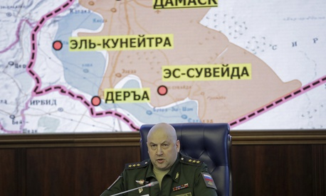 Colonel General Sergei Surovikin, Commander of the Russian forces in Syria, speaks, with a map of Syria projected on the screen in the back, at a briefing in the Russian Defense Ministry in Moscow, Russia, Friday, June 9, 2017.