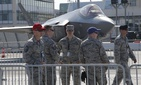 U.S. servicemen gather next to a F-35 Lightning II at Paris Air Show, on the eve of its opening, in Le Bourget, east of Paris, France, Sunday, June 18, 2017.