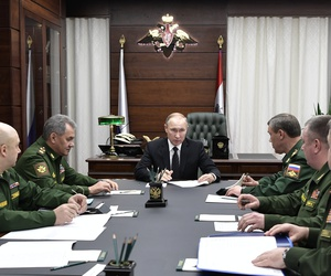 Russian President Vladimir Putin, center, meets with senior military officials in Moscow last year.