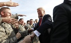 President Donald Trump greets members of the military as he arrives on Air Force One at Harrisburg International Airport in Middletown, Pa., Saturday, April, 29, 2017.