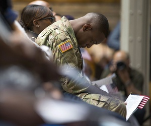 U.S. Army Specialist Shane Cardel, originally from Jamaica, bows his head after taking the Naturalization Oath of Allegiance at a ceremony in New York in late June.