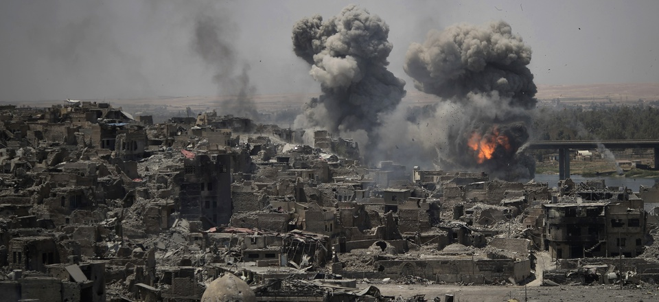 """Airstrikes target Islamic State positions on the edge of the Old City a day after Iraq's prime minister declared """"total victory"""" in Mosul, Iraq, Tuesday, July 11, 2017."""