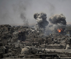 "Airstrikes target Islamic State positions on the edge of the Old City a day after Iraq's prime minister declared ""total victory"" in Mosul, Iraq, Tuesday, July 11, 2017."