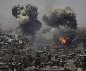 "Airstrikes target Islamic State positions on the edge of the Old City a day after Iraq's prime minister declared ""total victory"" in Mosul, Iraq, Tuesday, July 11, 2017"