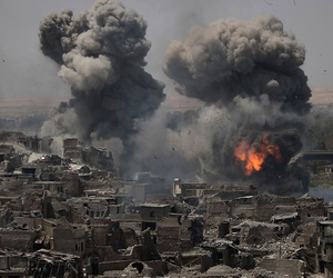 """Airstrikes target Islamic State positions on the edge of the Old City a day after Iraq's prime minister declared """"total victory"""" in Mosul on Tuesday."""