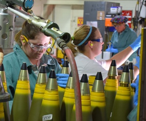 "A Crane Army Ammunition Activity explosives operator torques the fuse to a 5""/54 projectile body during 2017 production in Crane, Indiana."